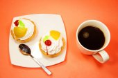 Cup of coffee and two fruit cake — Stock Photo