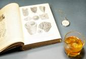 Glass of whiskey, pocket watches and open book  — Stock Photo