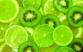 Green slice of lime and kiwi background — Stock Photo