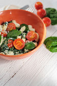Salad with pasta, spinach, tomatoes cherry and ricotta on white  — Stock Photo