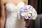 Bride holding a bouquet — Stock Photo