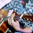 Guitarist is Playing guitar at live concert — Stock Photo #66085323