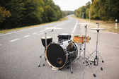 Drum Set on the road summer time — Stock Photo