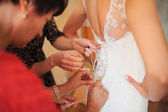 Bride getting dressed — Stock Photo