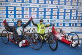 The three winners of the race handbike. — Stock Photo