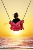 Little girl on the swing — Stock Photo