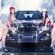 Two sexy girls in car wash — Stock Photo #76783655
