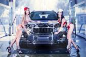 Two sexy girls in car wash — Stock Photo