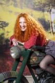 Redhad girl on motorbike — Stock fotografie