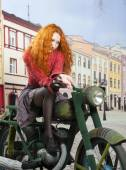 Redhad girl on motorbike — Stock Photo
