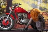 Redhad girl on motorbike — Foto Stock