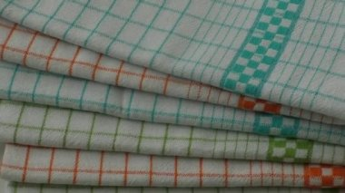 Colorful dish towels on wooden table — Stock Video