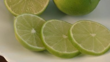 White plate with slices of lemon — Stock Video