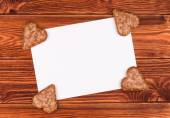 Paper card for greeting on the wooden background. — Stock Photo