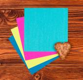 Paper card for greeting on the wooden background — Stock Photo