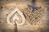Rattan heart on the wooden background. — Stock Photo