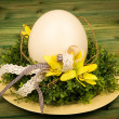 Easter - decorative composition with wreath and egg on the wooden background. — Stock Photo #68471881