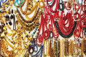 The variety of colorful  amber necklaces. — Stock Photo
