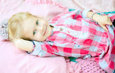 Girl lying on coverlet — Stock Photo