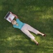 Woman laying in grass — Stock Video #65524515
