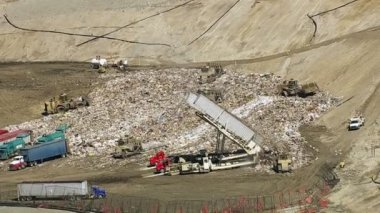 Trucks and tractors working in landfill — Stock Video