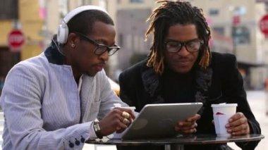 Friends looking at digital tablet — Stock Video
