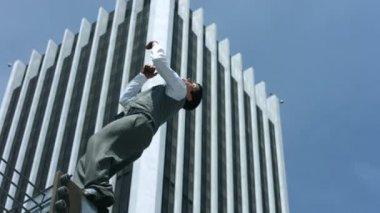 Businessman does back flip — Stock Video