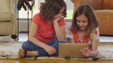 Girls using digital tablet — Stock Video