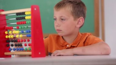 Boy counting with abacus — Stock Video