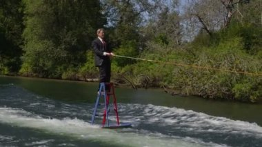 Water skiing on ladder — Stockvideo