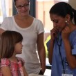 Pediatrician with mother and child — Stock Video #65544587