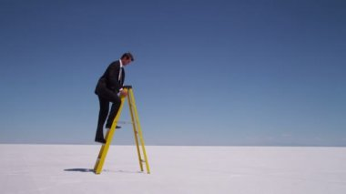 Businessman climbs a ladder — Stock Video