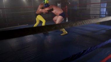Masked men wrestle — Stock Video