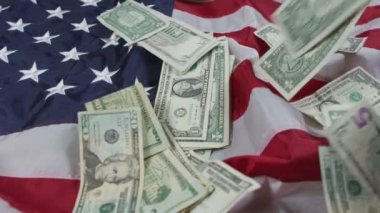 Money on US flag — Stock Video