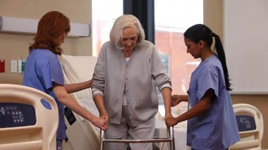Nurses assist woman — Stock Video