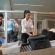 Travelers after baggage screening — Stock Video #65591251