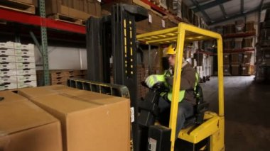 Forklift operator in warehouse — Stock Video