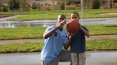 Father teaching son to play basketball — Video Stock