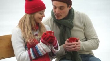 Couple drinking hot beverages — Stock Video