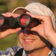 Man looking through binoculars — Stock Video #65601705