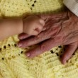 Baby and grandma's hands — Stock Video #65608971