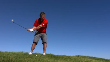 Golfer hits ball — Stock Video