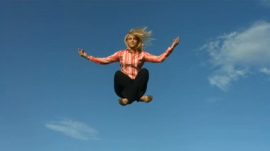 Woman meditating in mid air — Stock Video