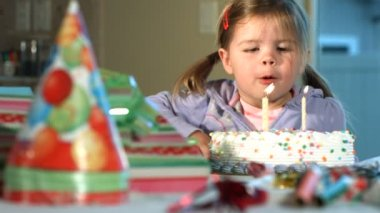 Girl blowing out birthday candles — Stock Video