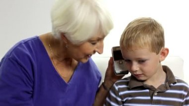 Woman and boy talking on cell phone — Stock Video