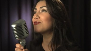 Singer sings into microphone — Stock Video