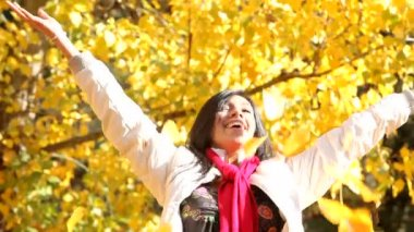 Woman throwing fall leaves — Stock Video