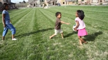 Siblings playing football — Stock Video