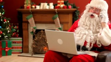 Santa Claus with laptop — Stock Video
