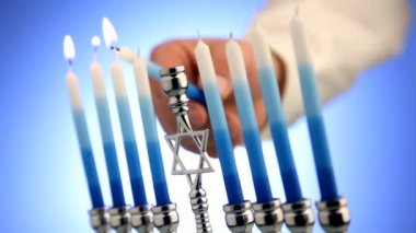 Person lighting menorah — Stock Video